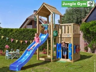 Jungle Gym mansion playhouse with blue slide in garden