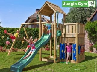 Jungle Gym mansion with playhouse swing and dark green slide in garden