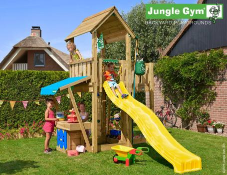 Jungle Gym mansion mini market with yellow slide in garden