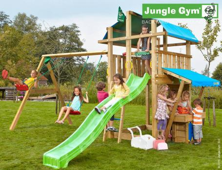 Jungle Gym fort mini market 2 swing with green slide in garden