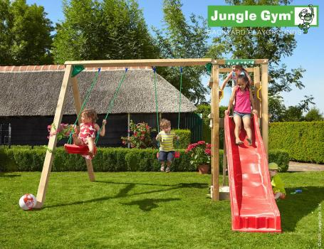 Jungle Gym tower with swings and red slide in garden