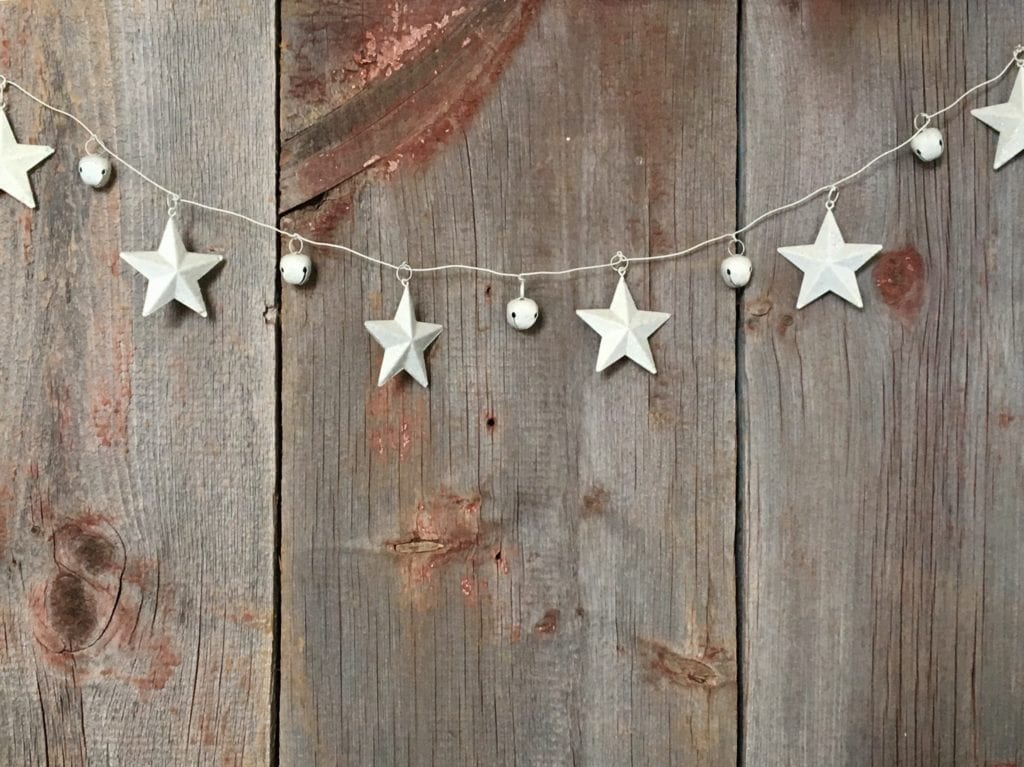 Silver star and ball bunting hung on a wooden background
